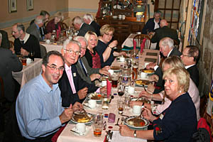 "Rotarians enjoying their ""frugal"" meal"