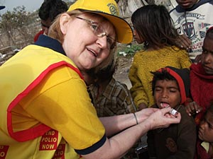 Giving Polio immunisation drops in India